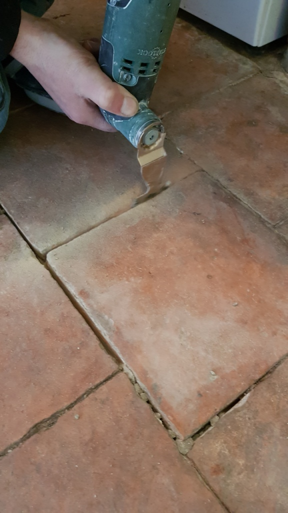 Pamment Tiled Floor During Grout Removal in Silkstone
