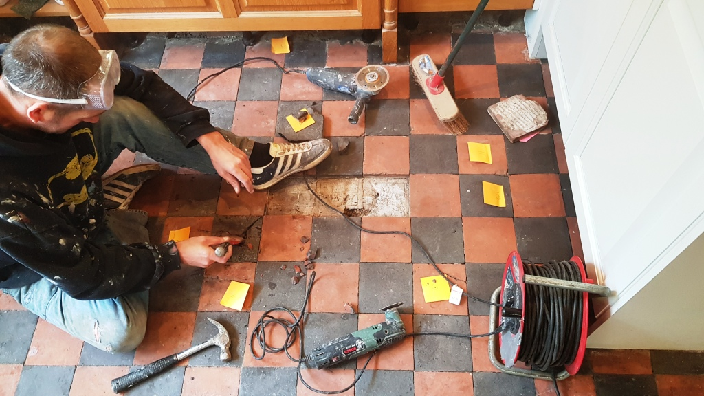Quarry Tiled Floor Sheffield During Restoration Day 3 Removing More Damaged Tiles